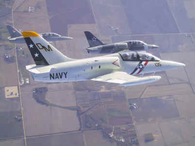 L-39 formation cavorts over Illinois farm fields.